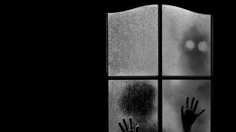 small alien at window for feature