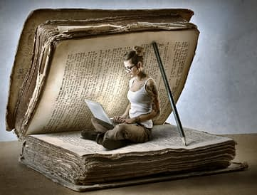 Woman writing inside an old book